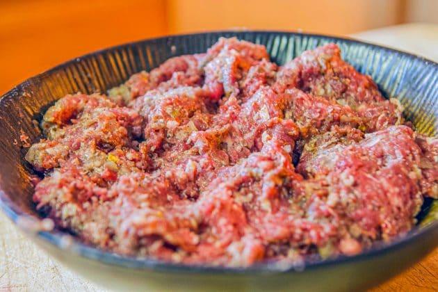 raw kabob meat mix in a dark bowl