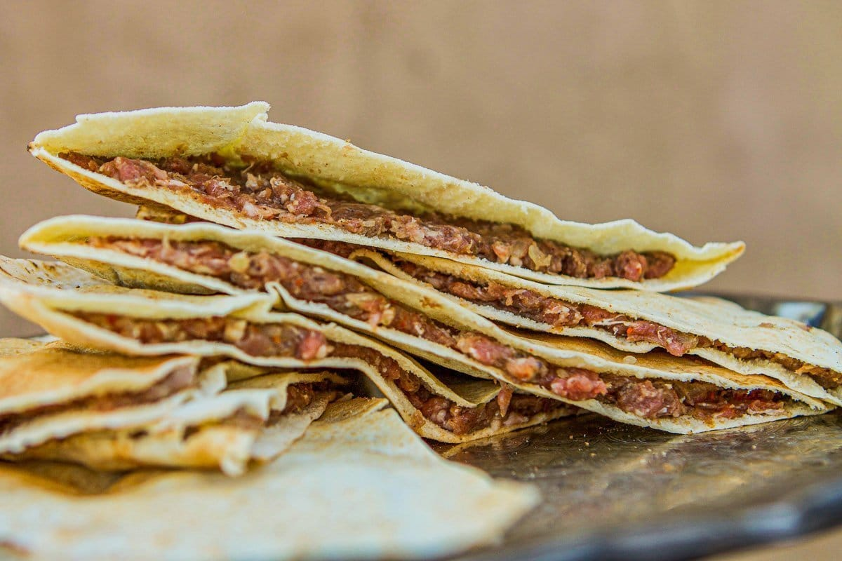 pita bread filled with raw meat for arayes