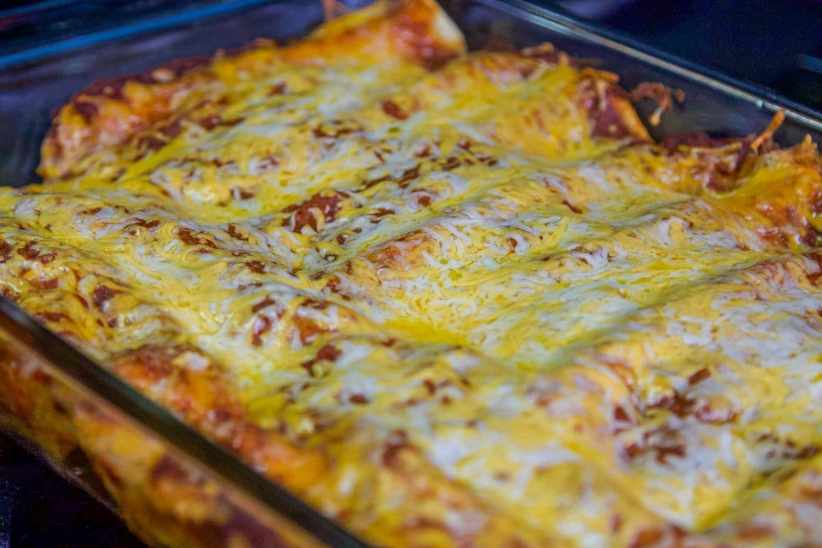 pulled pork enchiladas in a pan