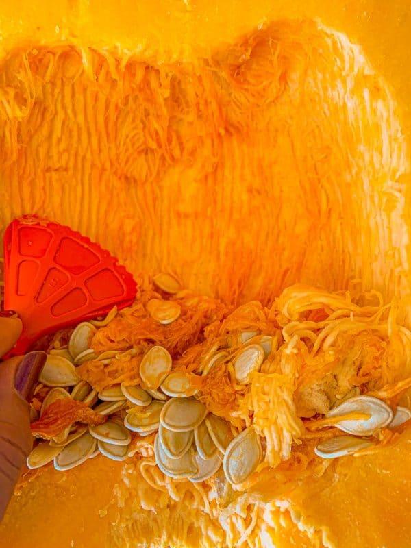 scraping the inside of a pumpkin