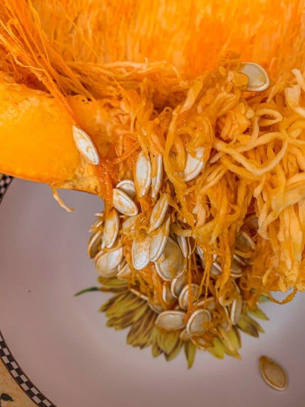 seeds being taken out of a pumpkin