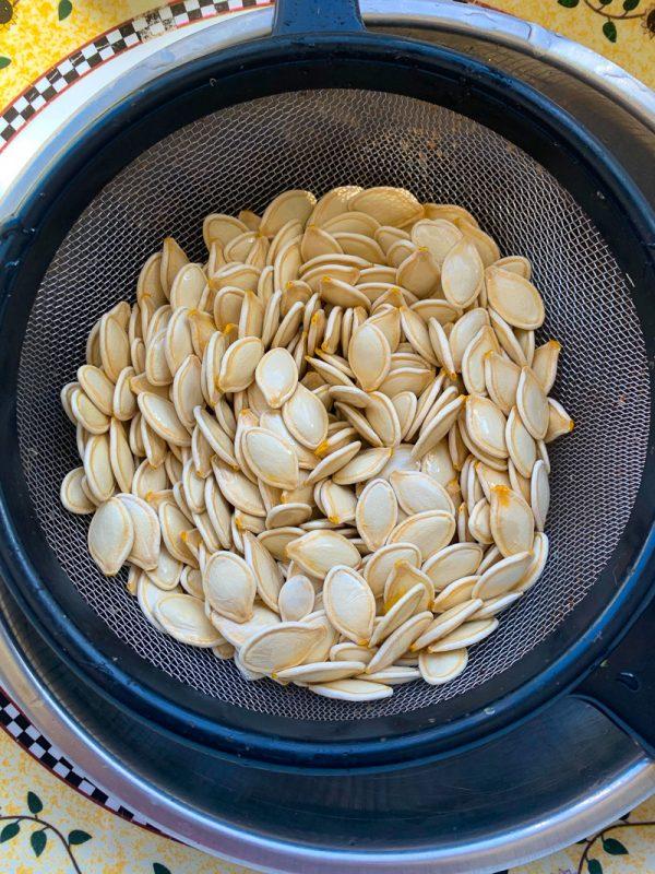 pumpkin seeds in a strainer