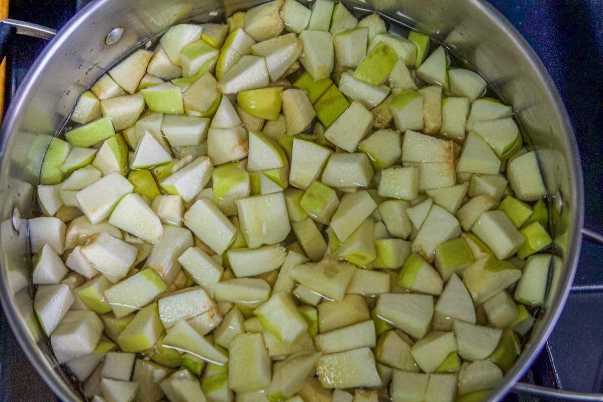 chopped quince in a pot for jam