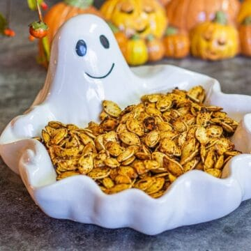 roasted pumpkin seeds in a ghost bowl