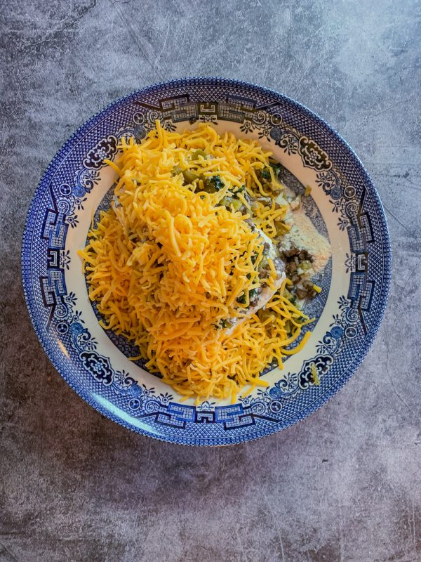 blue willow bowl with cheese and other stuffed mushrooms ingredients