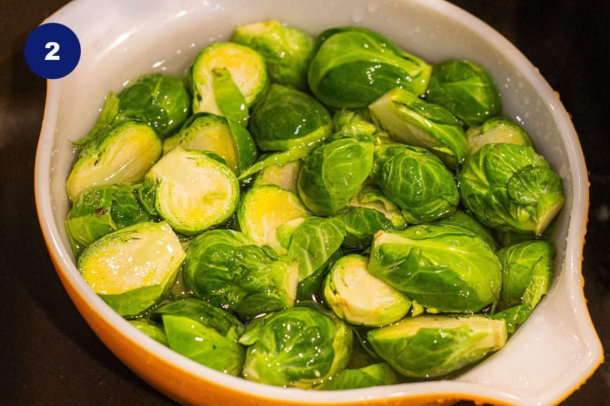 sliced brussel sprouts in a bowl soaking in water