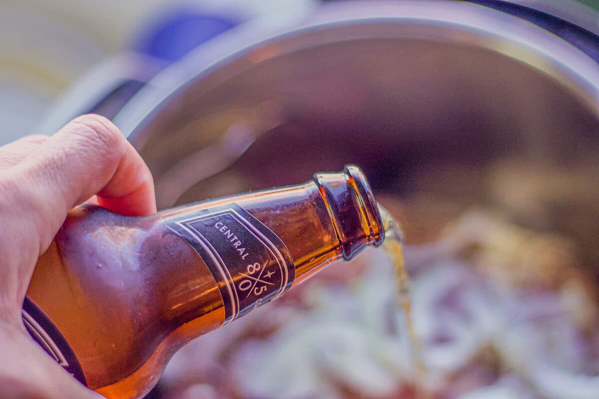 pouring beer over corned beef