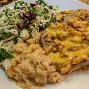 pork chops and potatoes and salad