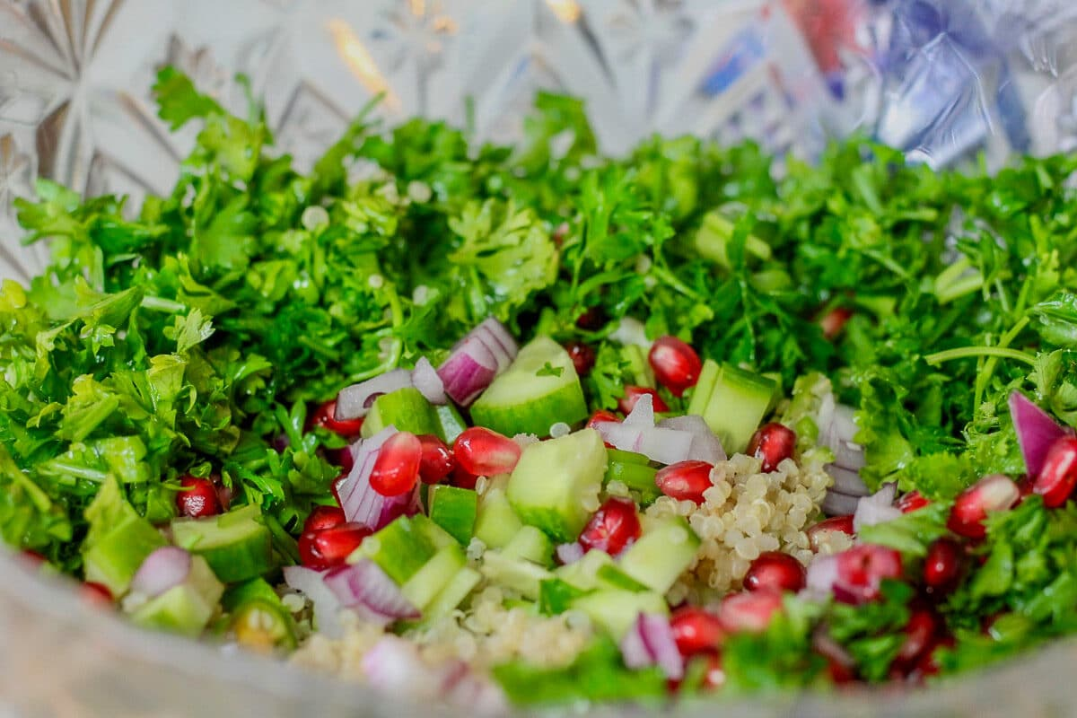 diced quinoa salad ingredients in a bowl