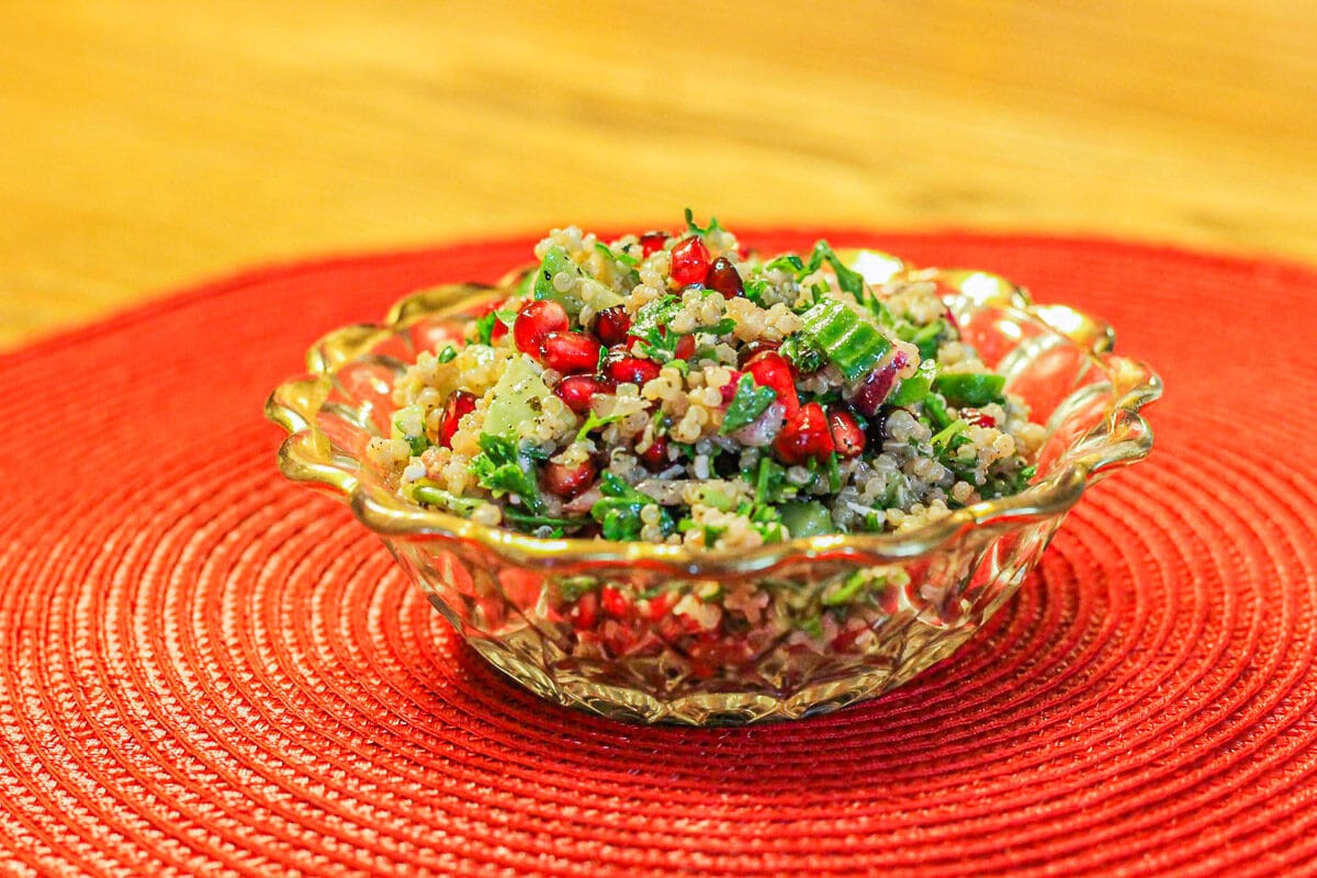 quinoa salad in a bowl over a red mat