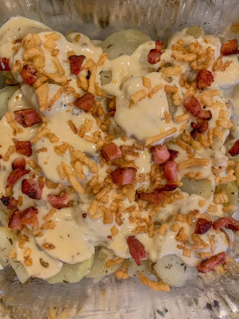 scalloped potatoes layered with cheese bacon and French fried onions