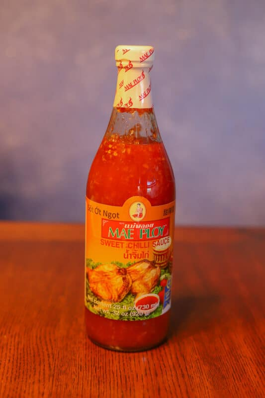 chili sauce in a bottle on the table