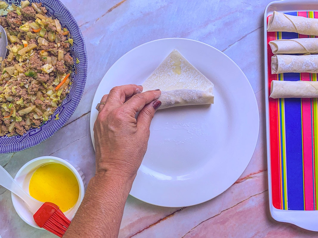 rolling lumpia on a plate