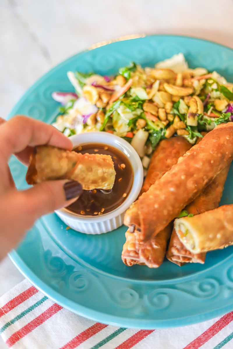 dipping lumpia in chili sauce