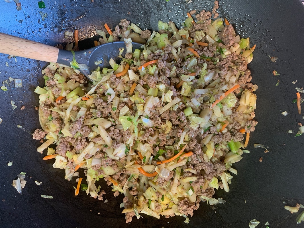 meat and veggies sautéed in a pan