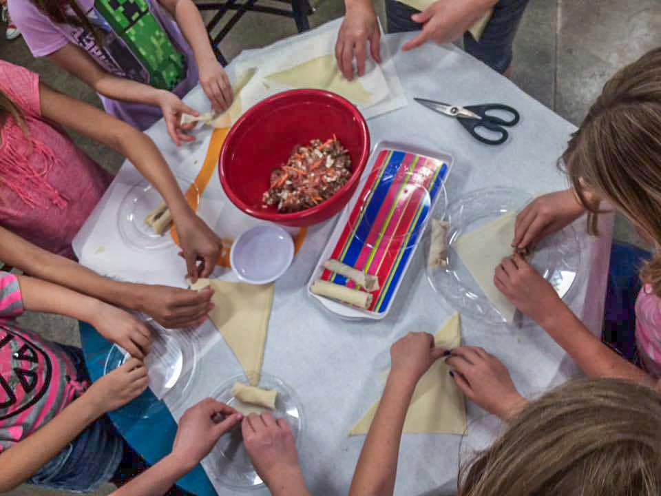kids making lumpia