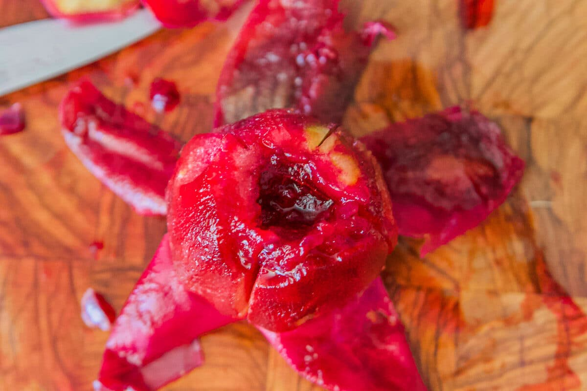 peeled prickly pear on a cutting board