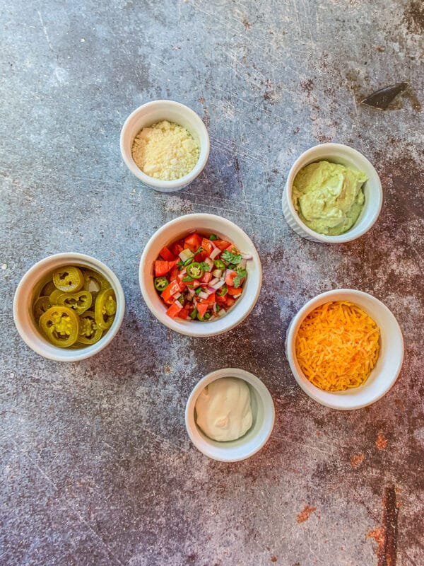 mexican fixings in white bowls