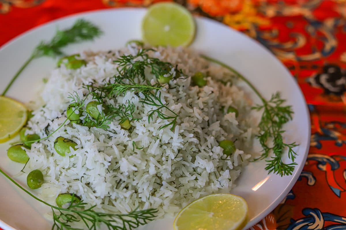 dill rice on a plate with lime slices