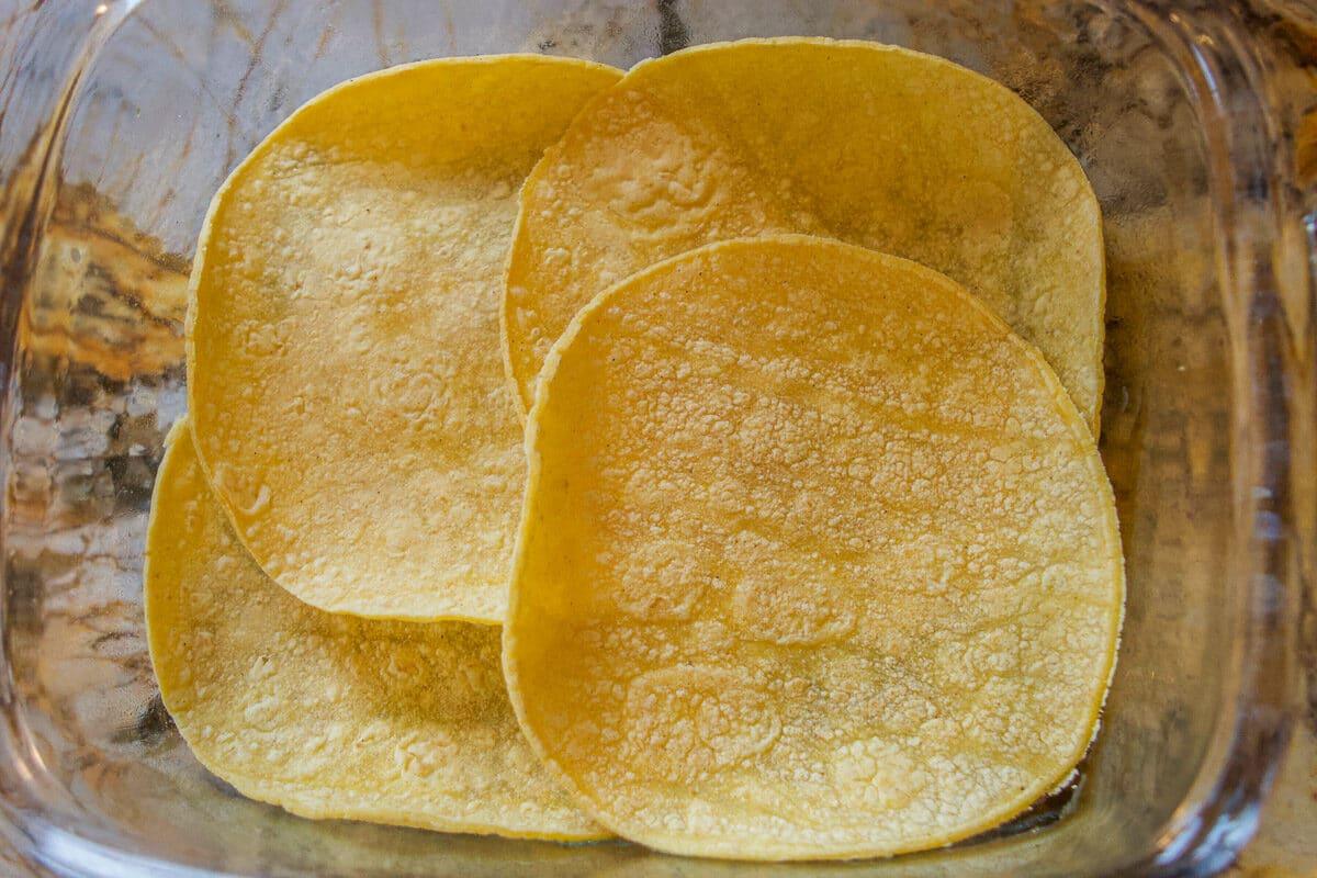 four tortillas in a dish