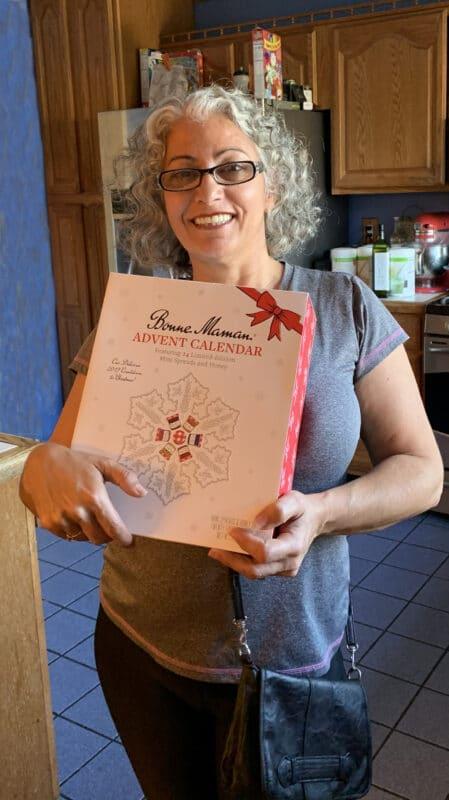 woman holding an advent calendar