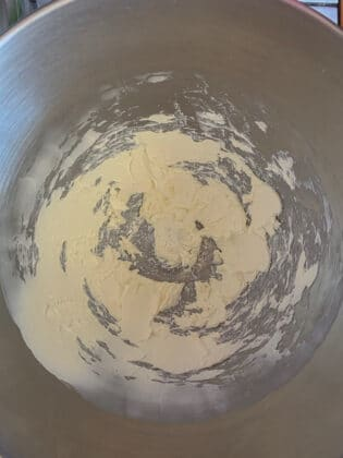 creamed cream cheese in a mixing bowl
