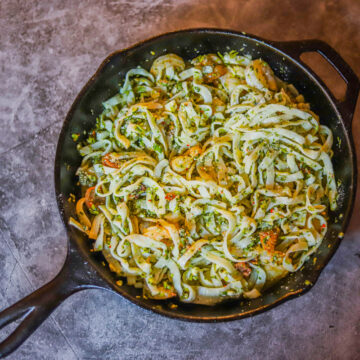 protein noodles with Chimichurri sauce in a skillet
