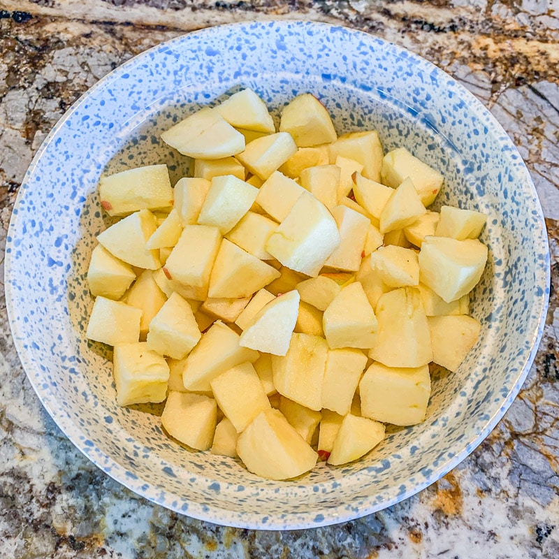 chopped apples in a light blue, spotted bowl