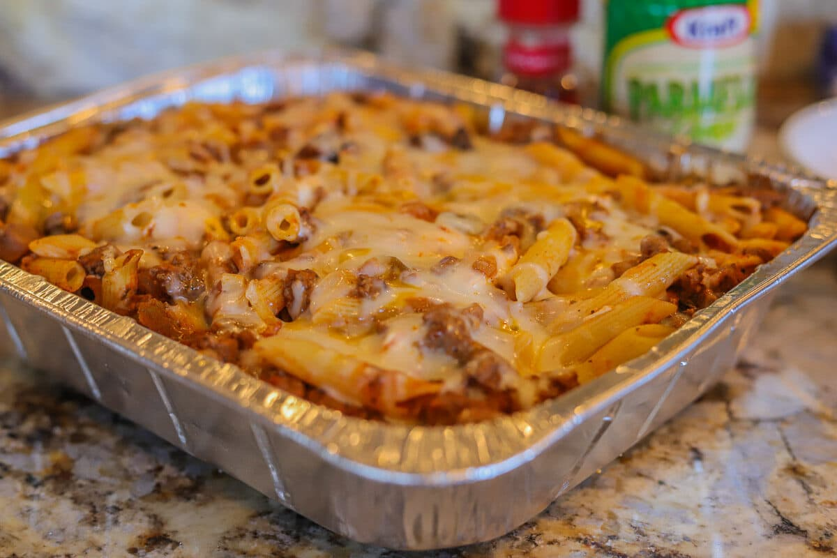 baked penne pasta in a foil pan