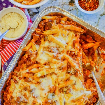 baked penne pasta with fixings on the side