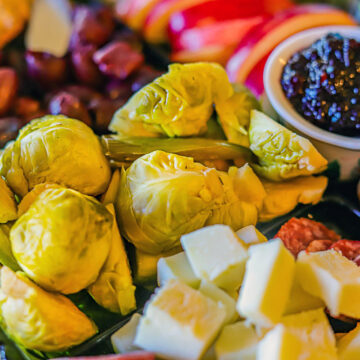 platter with Pickled Brussel Sprouts, jam, cheese, and olives
