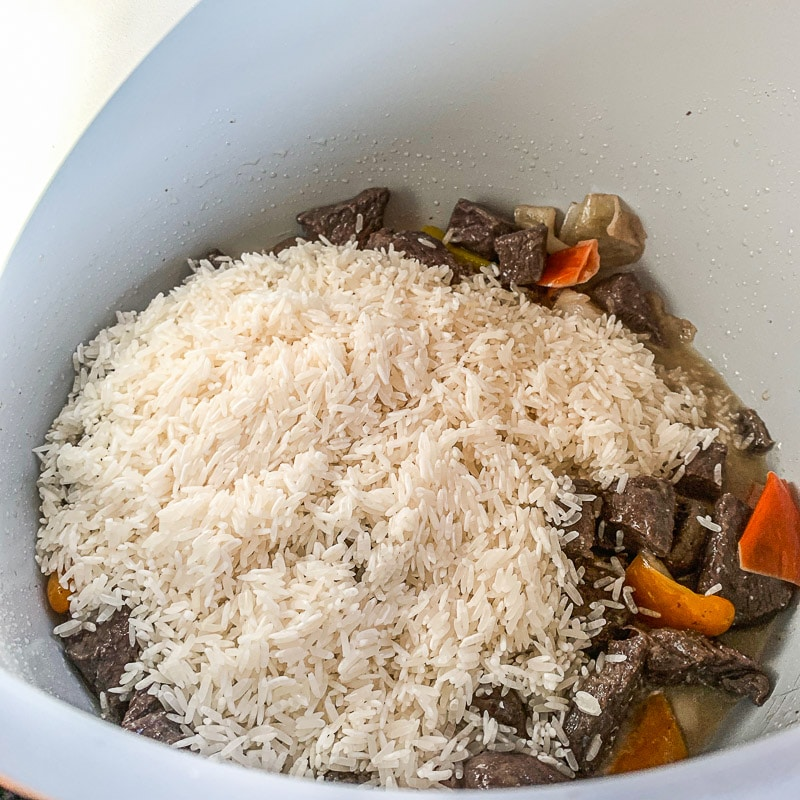 rice and meat, veggies in a pot