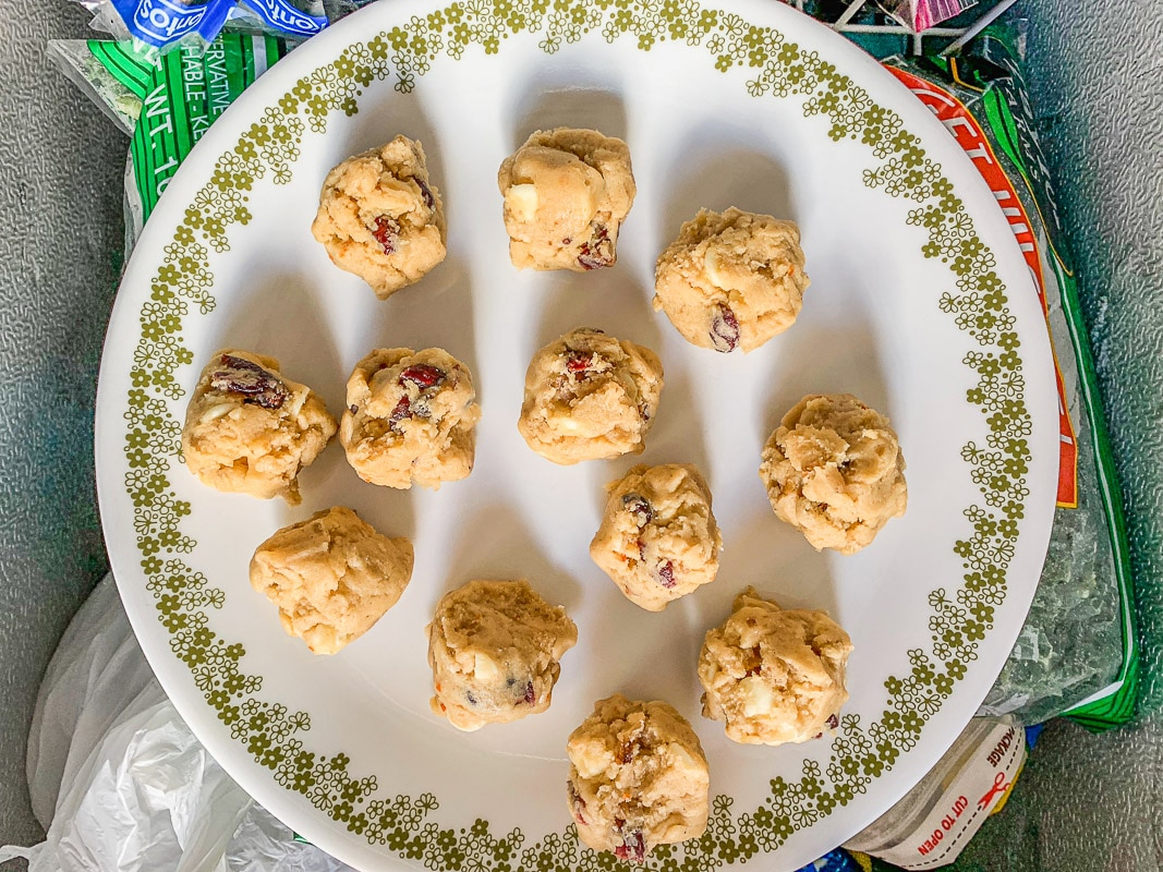 frozen cookies on a white plate with green trim