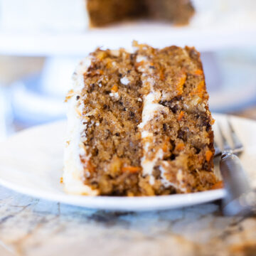 carrot cake with pineapple on a white place with a fork