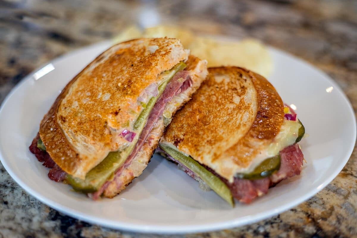 Reuben Sandwich recipe on a white plate
