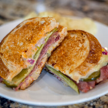 Reuben Sandwich recipe on a white plate