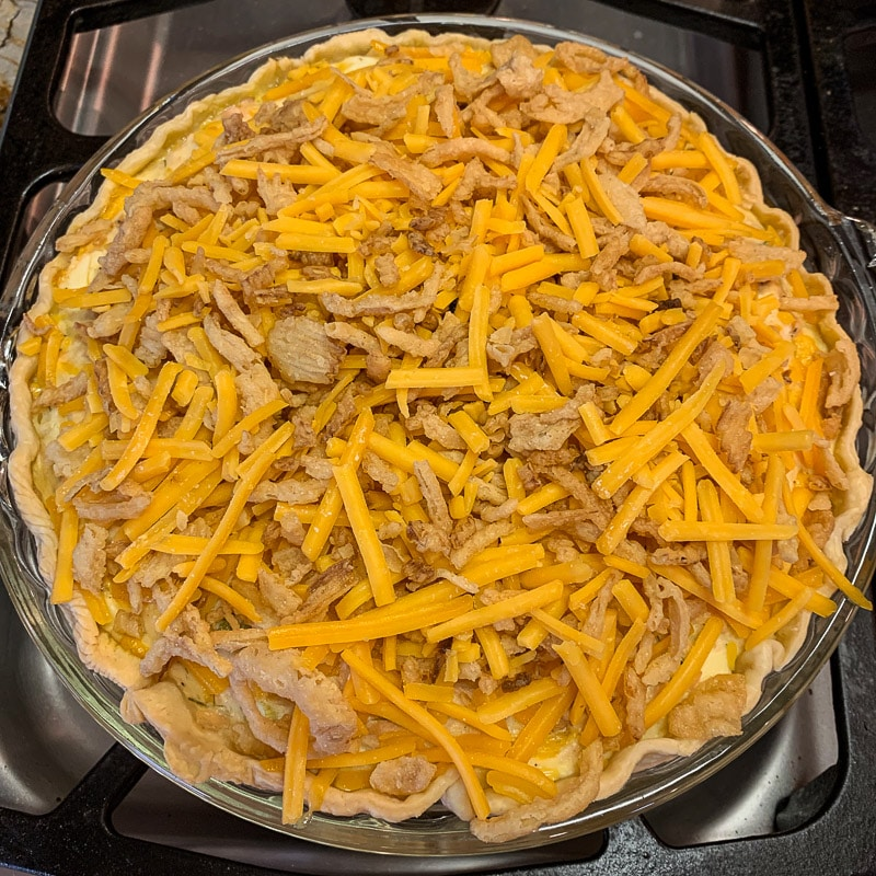 salmon pie with fried onions and cheese