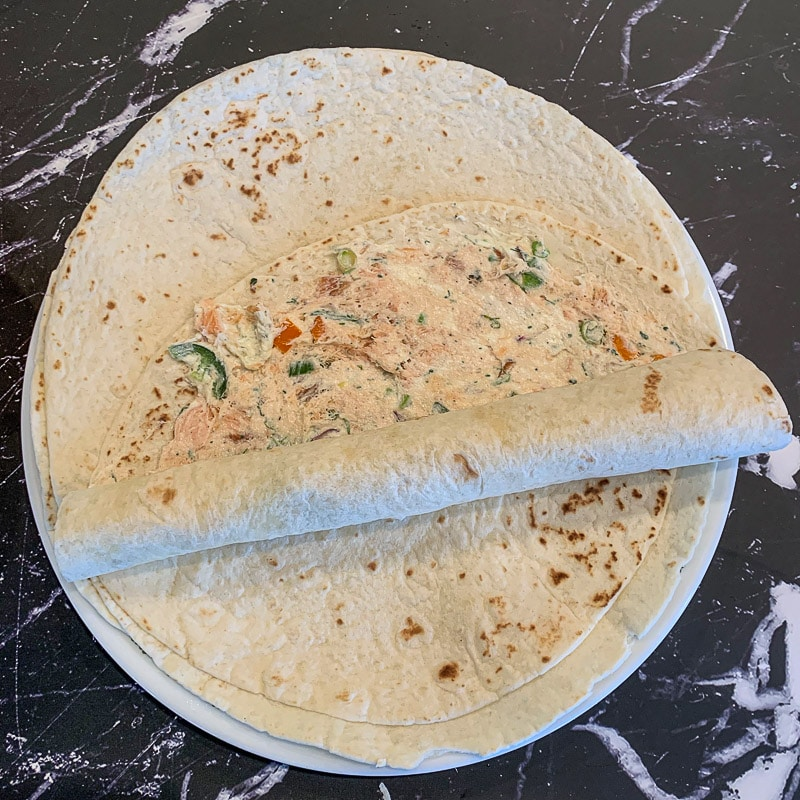 tortilla half rolled up with spread