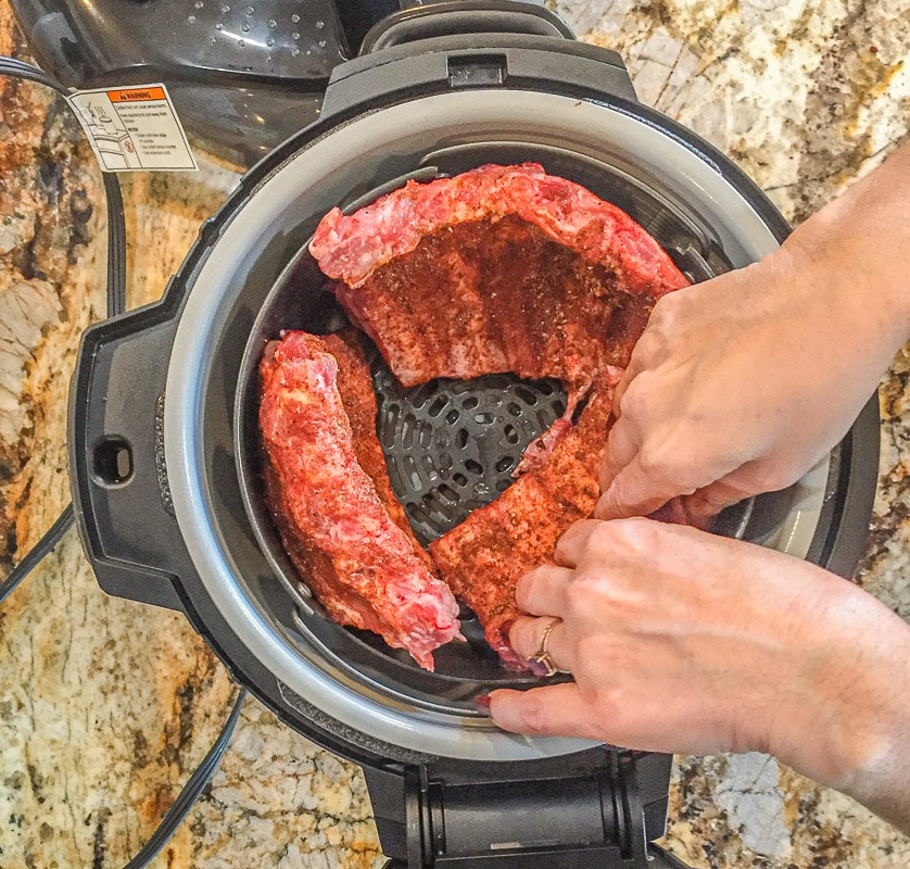 placing ribs in a pressure cooker