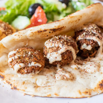 falafelrecipe in a flat bread with salad main image