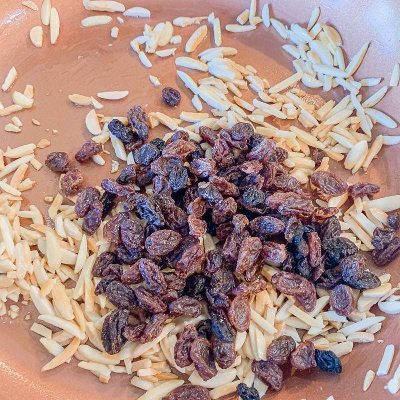 slivered almonds and raisins in a pan