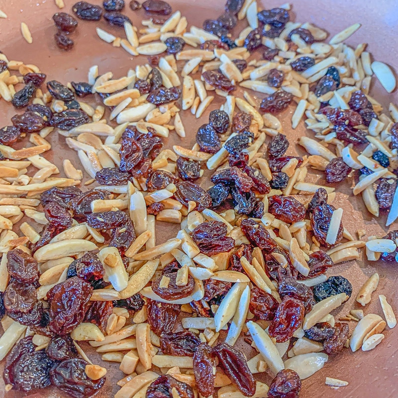 toasted raisins and slivered almonds in a brown pan
