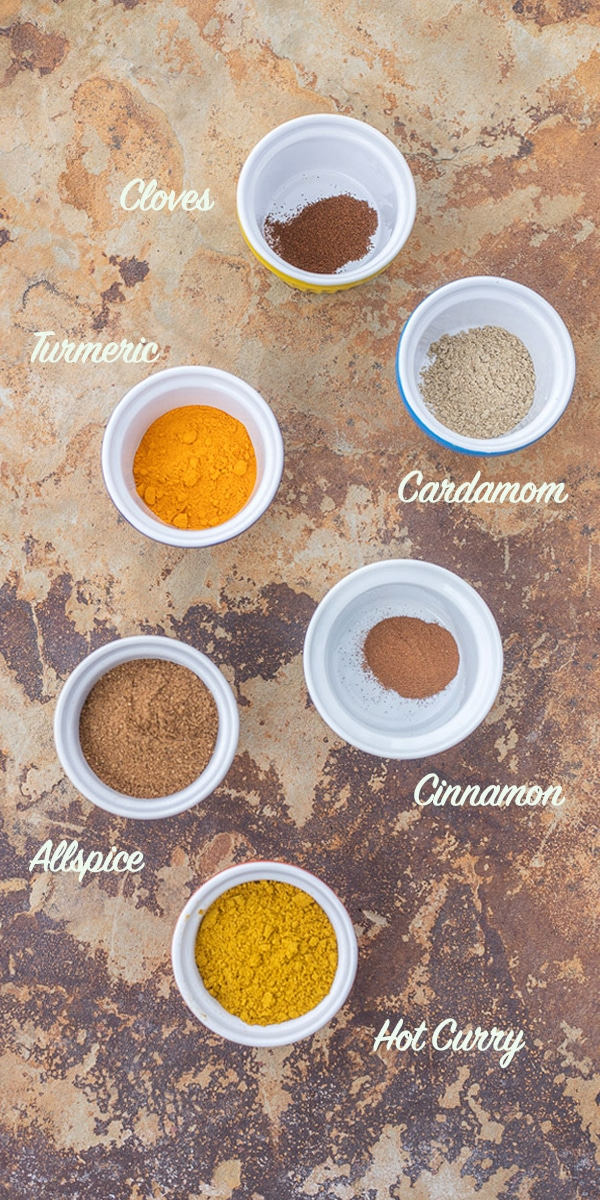 biryani spices in small bowls labeled