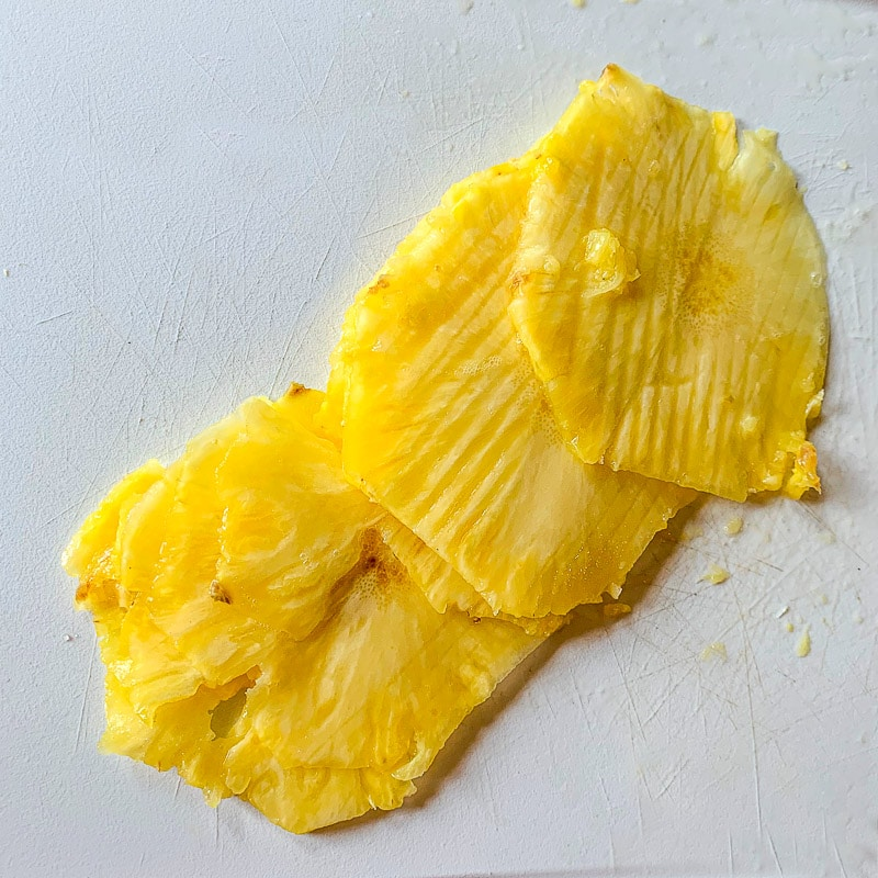 sliced pineapple on a cutting board