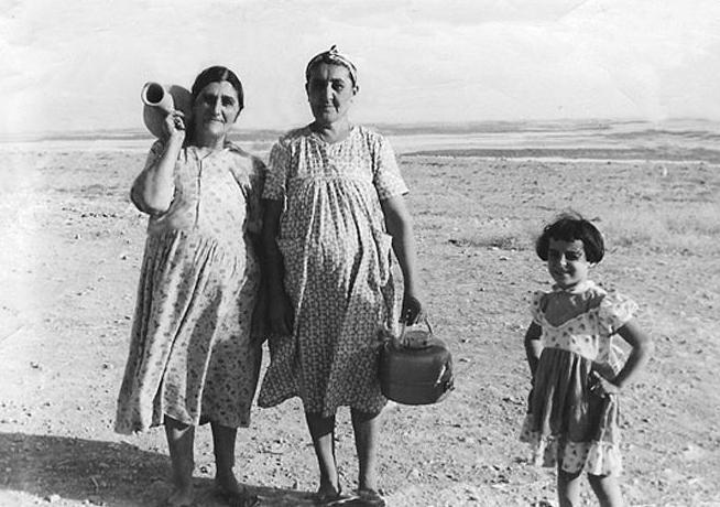 grandma carrying a jar over her shoulder