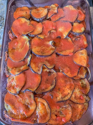 Tepsi: cooked eggplant casserole with tomato sauce on top