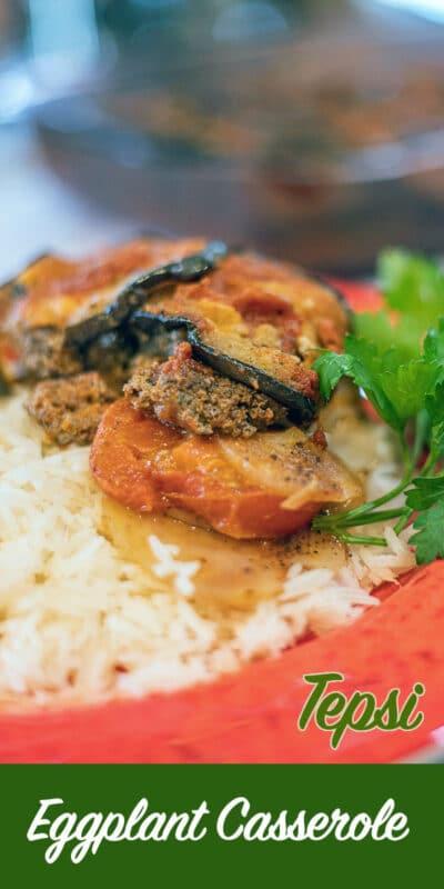 eggplant casserole over white rice pin