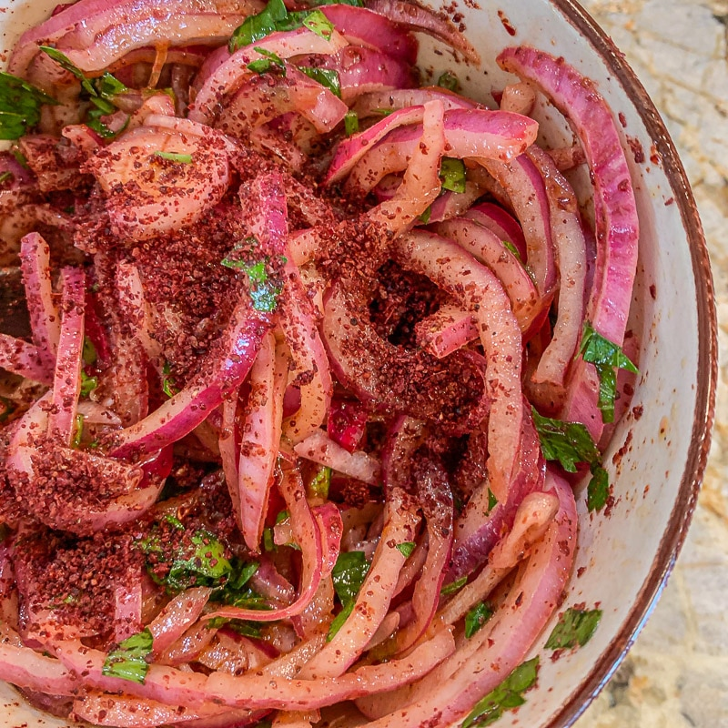 marinated sumac onions in a bowl