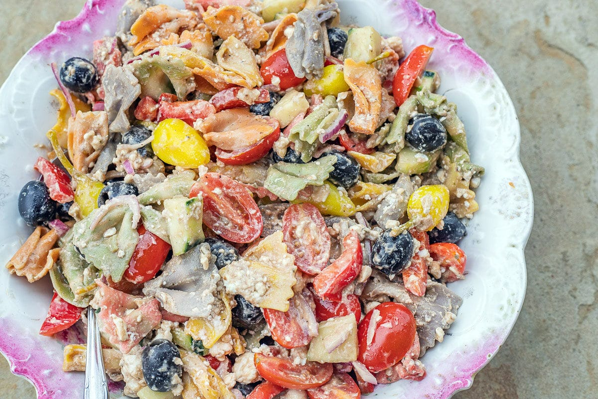 pasta salad in a white and pink bowl