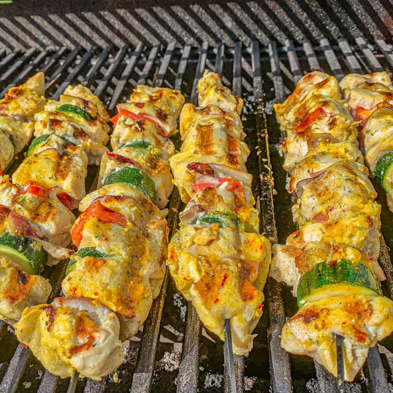 Joojeh/chicken Kabab and sliced veggie skewered on a grill